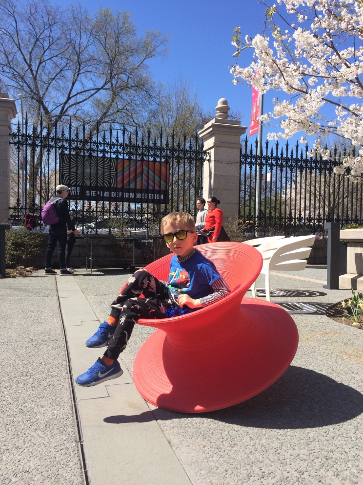Spun Chair Red in the garden